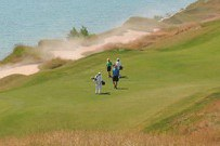 Golfers walking on a golf course