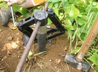 Car jack used to pull out soil corer